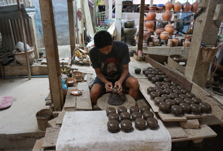 they make clay pots with an incredible amount of detailed that's been cut away by hand, plus plain useful ones to use for hot pot or other cooking needs.