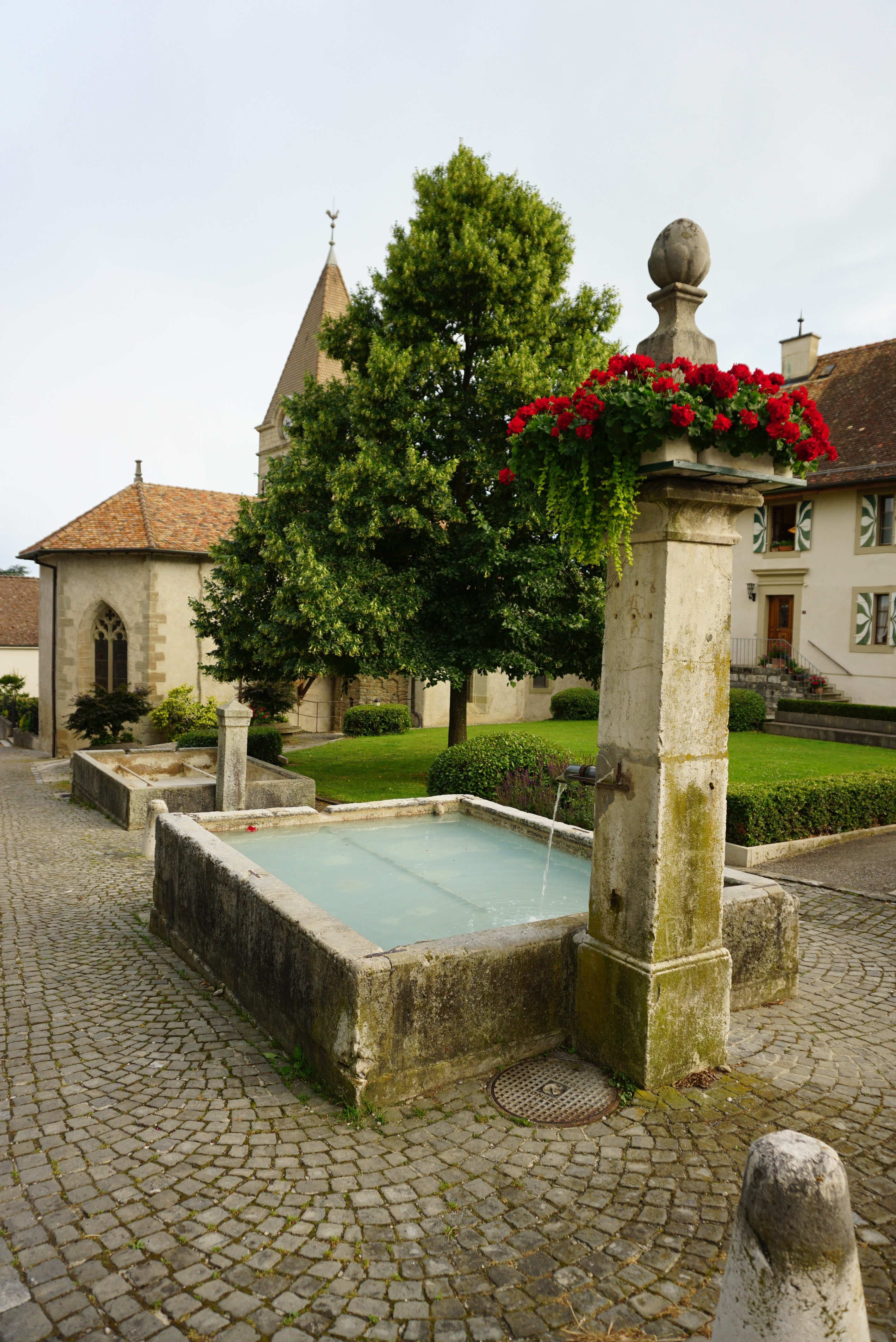 there are fountains throughout these small towns dating back to the 1800s. You can see our old church behind it.