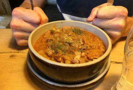 bigos, a hunters stew with sauerkraut, sausage and pork