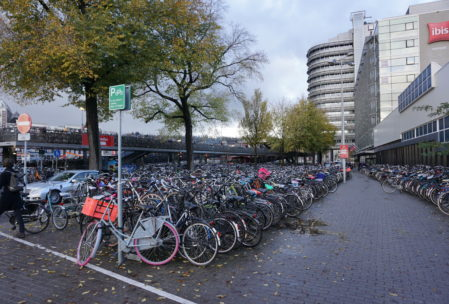 instead of car parking garages, they had bike parking lots and covered bike parking garages at the train station for all the commuters!